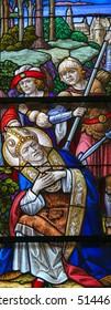 MECHELEN, BELGIUM - JANUARY 31, 2015: Stained Glass window depicting the Martyrdom of Saint Rumbold, patron saint of Mechelen, in the Cathedral of Saint Rumbold in Mechelen, Belgium.
