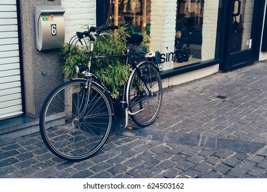 Mechelen, Belgium - July 28, 2016:  Bicycle parked in a front shop in Mechelen. It is one of most prominent  cities of Belgium in historical art.