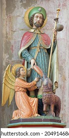 MECHELEN, BELGIUM - JUNE 14, 2014: The carved and polychromed statue of st. Roch in church Our Lady across de Dyle.