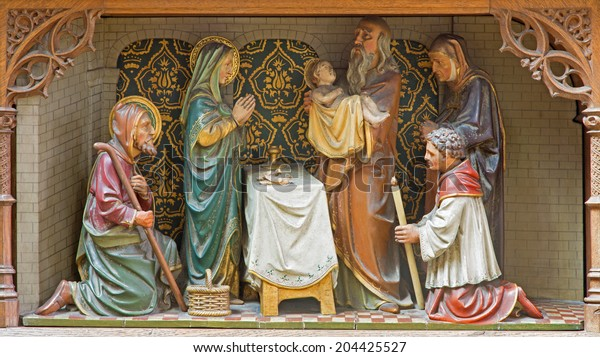 MECHELEN, BELGIUM - JUNE 14, 2014: Carved sculptural group of The Presentation of Jesus in the Temple scence on the new gothic side altar of church Our Lady across de Dyle.