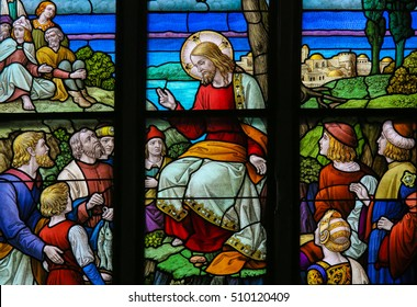 MECHELEN, BELGIUM - NOVEMBER 4, 2016: Stained Glass window depicting the miracle of Jesus feeding the multitude with loaves of bread and fish in the Cathedral of Saint Rumbold in Mechelen, Belgium.