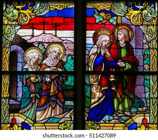 MECHELEN, BELGIUM - NOVEMBER 4, 2016: Stained Glass window depicting Mary of Clopas, Mary Magdalene, Mother Mary and Saint John the Apostle on Good Friday, in the Cathedral of Mechelen, Belgium.