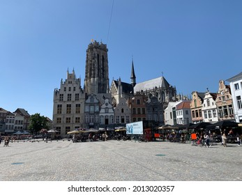Mechelen, Province of Antwerp, Belgium- July 17, 2021: Mechelen city skyline with Brabantian Gothic style St. Rumbold's Cathedral, market square (grote markt) and old houses.