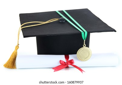 Medal for achievement in education with diploma and hat isolated on white
