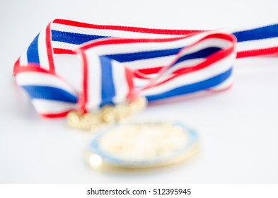 Medal Award winning sports blur with Thailand flag adorned ribbon on white