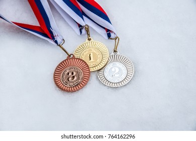 Medal, Award, Winning. White, snow background. Winter olympic game. South Korea 2018.