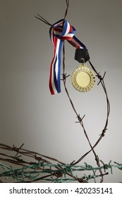 medal hanging on the barbed