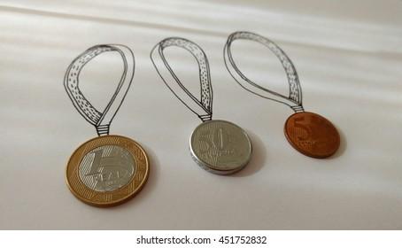 Medal illustration using brazilian coins. Gold, silver and bronze medals. Rio de Janeiro, Brazil 2016.
