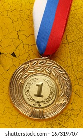 Medal on cracked piece of old wall