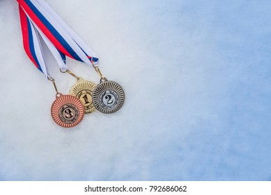 Medal set in winter snow background. Medal set, sport trophy. Original wallpaper for winter olympic game.