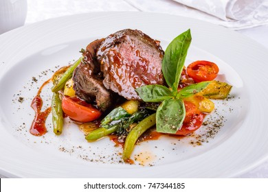 Medallions of veal with vegetables