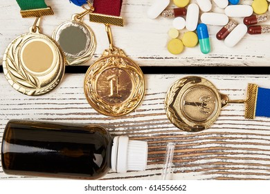 Medals, pills and bottle. Issue of doping in sport.
