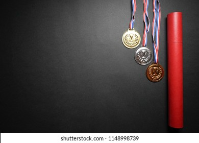 Medals and red scroll case