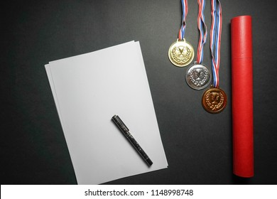 Medals, scroll case and empty white paper