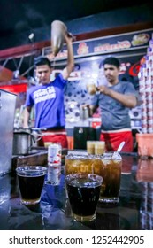 Medan, Indonesia - 26th February 2016: Two Glass of Espresso and Ice Tea with A Man Making A Glass of Warm Sanger Coffee (Aceh Traditional Cappucino) in the Background