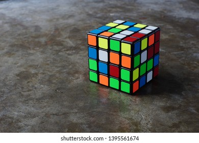 Medan, Indonesia - April 30, 2019 : Rubik's cube on the abstract floor background. Rubik's Cube invented by a Hungarian architect Erno Rubik in 1974