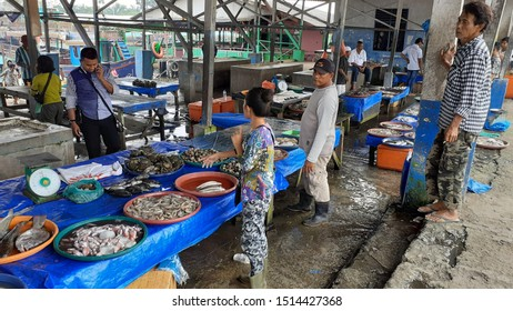 Medan, Indonesia - ca 2019: Blurry, partially focus image of the atmosphere of daily busyness in the fish market and fish auction, Percut beach.