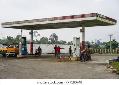 MEDAN, INDONESIA- December 15, 2017 : Petrol attendant filling up motorcycle from a pertamina fueling station in Medan Indonesia.