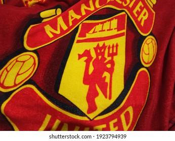 MEDAN, INDONESIA - FEBRUARI 25th, 2021 - Manchester United Logo red in blanket
