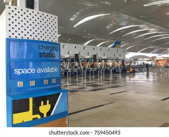 MEDAN, INDONESIA - OCTOBER 4, 2017 : A Mobile Charging Space Area Near To Check In Counter At Kualanamu International Airport.
