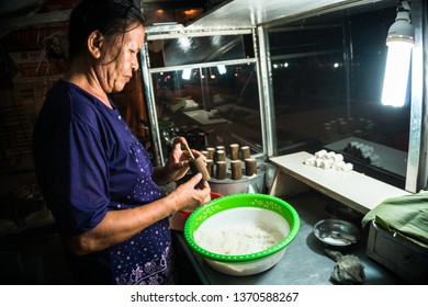Medan, Indonesia - September 2,2015: Women make Putu Bambu cakes. Kue Putu bamboo is a traditional Indonesian cake made from rice flour, brown sugar, palm sugar, and coconut.