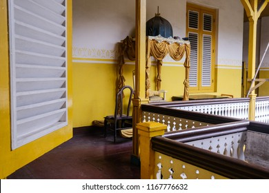 Medan, Indonesia-August 2018: Beautiful corners of the Maimun Palace in Medan, North Sumatera. The color of yellow dominates the whole Sultanate Royal Building.This palace is open for public every day