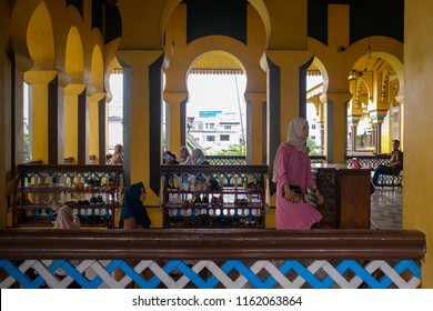Medan, North Sumatera-22 August 2018: People walk around Maimun Palace on Public Holiday of Eid Al Adha. This palace is the heritage of The Sultanate of Deli from 17th centuries in Sumatera.