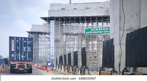 Medan, North Sumatera/Indonesia - March 15,2020 : Container cars are crossing toll roads that are under construction