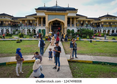Medan, North Sumatera/Indonesia-November 2018: The people enjoy the beauty of Istana Maimun (Maimun Palace). This palace,the heritage of Deli Sultanate, is a popular destination in Medan.