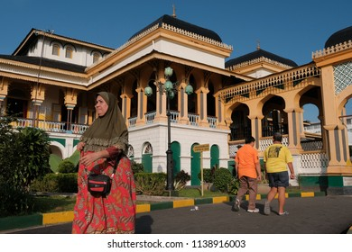 Medan, North Sumatera-November 2017: People walk around Maimun Palace.It is the heritage of The Sultanate of Deli from 17th centuries in Sumatera. It is now become a museum and open for public.