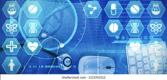 Medecine against overhead view of wireless computer mouse and keyboard with stethoscope