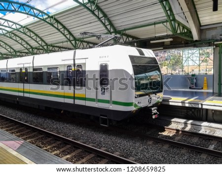 Medellin, Antioquia, Colombia - 07/17/2018: Detail of a metro train vehicle from the Medellin Metro (Colombia) stopped at one of the stations waiting for passengers to board.
