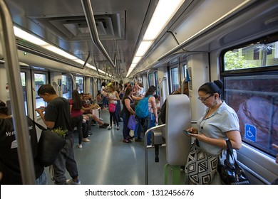 Medellin, Colombia - August 20, 2018: people traveling with the modern metro car