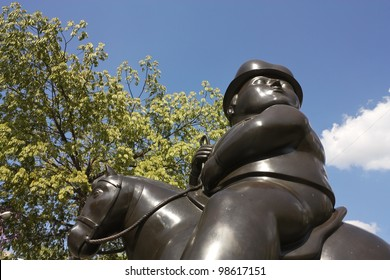 MEDELLIN, COLOMBIA - JAN 2: Statue 'Raider' in Botero Square, on January 2, 2010 in Medellin, Colombia.  Launched in 2002, Botero Square are displayed in the street 23 sculptures by Fernando Botero.