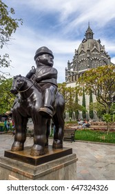 MEDELLIN, COLOMBIA - Jul 19, 2016: Man on a horse statue at Botero Square Botero Square - Medellin, Antioquia, Colombia