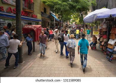 Medellin, Colombia - July 23, 2018: people walking on the street in the city center