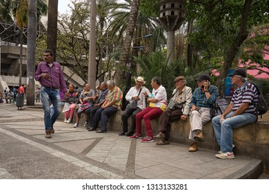 Medellin, Colombia - July 23, 2018: people sitting in Berrio park, a popular meeting place