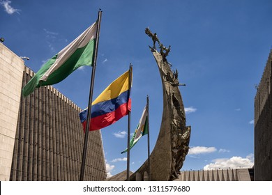 Medellin, Colombia - July 25, 2018: flags and statue at the Alpujarra administrative center of the city