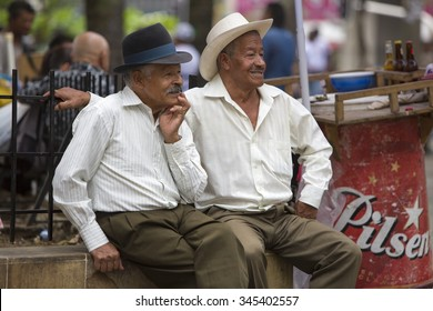 MEDELLIN, COLOMBIA, MARCH 14: Portrait of senior traditional colombian caucasian men with hats sitting and smiling together in a park in Medellin, Colombia 2015