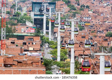 MEDELLIN, COLOMBIA - MARCH 8: Metrocable cars arriving at a station in Medellin, Colombia on March 8, 2014.  Metrocable is the first gondola lift system in the world dedicated to public transportation