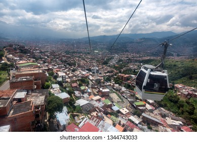 MEDELLIN, COLOMBIA - NOV 11: Aerial view of barrios from the Metro gondola in Medellin Colombia on November 11, 2017.  The gondolas link hard to access barrios to the main metro system in Medellin.