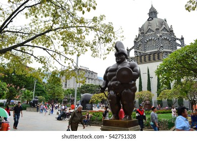 MEDELLIN, COLOMBIA - OCTOBER 18TH, 2016: Sculptures of the artist Fernando Botero at a squate and some unidentified people in the city of Medellin, Colombia, on October 18th, 2016