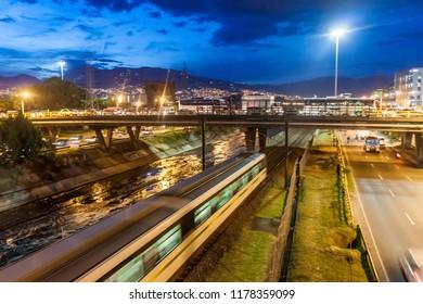 MEDELLIN, COLOMBIA - SEPTEMBER 1, 2015: Highway and metro tracks in Medellin.