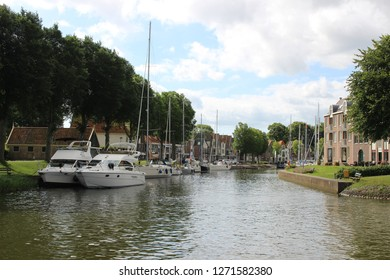 MEDEMBLIK, NETHERLANDS - 08/07/2017: Port entry to Medemblik, a town at the western edge of the Ijsselmeer.