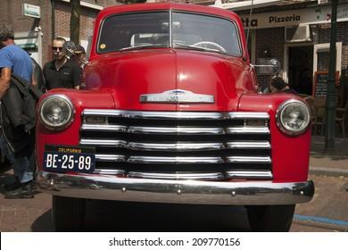 MEDEMBLIK, THE NETHERLANDS - JULY 27,2014: Red Chevrolet pickup 3100 , 1953 on a oldtimer show on july 27,2014 in Medemblik.