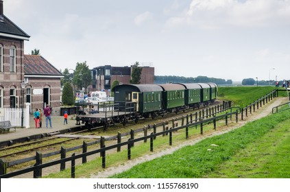 MEDEMBLIK, NETHERLANDS - SEPTEMBER 7, 2014: Vintage train wagons at railway station of Medemblik