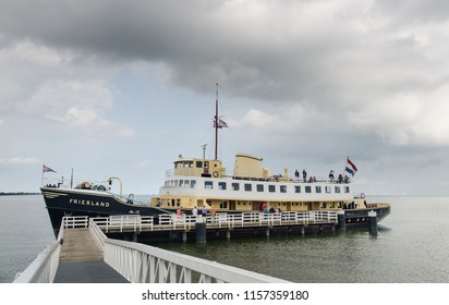 "MEDEMBLIK, NETHERLANDS - SEPTEMBER 7, 2014: The ""Friesland"" ship (1956) at Medemblik wharf. North Holland"