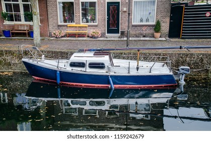 MEDEMBLIK, NETHERLANDS - SEPTEMBER 7, 2014: Motorboat on water in city of Medemblik, North Holland