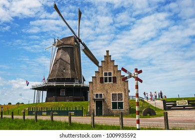 "MEDEMBLIK, WEST FRIESLAND / THE NETHERLANDS - IUJY 4, 2017: The restored windmill ""De Herder"" Medemblik is open to visitors"