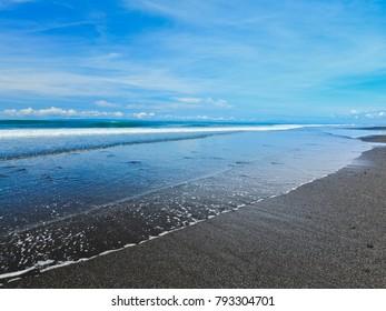 Medewi beach with black volcanic sand
